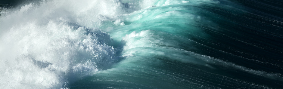 A large wave breaking into turbulent white water