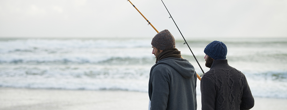 Two fishermen on a beach - Credit: iStock.com - People Images